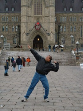 Gregory poses out front of the Parliament Buildings