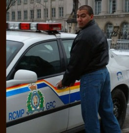 Pretending to get into the RCMP car